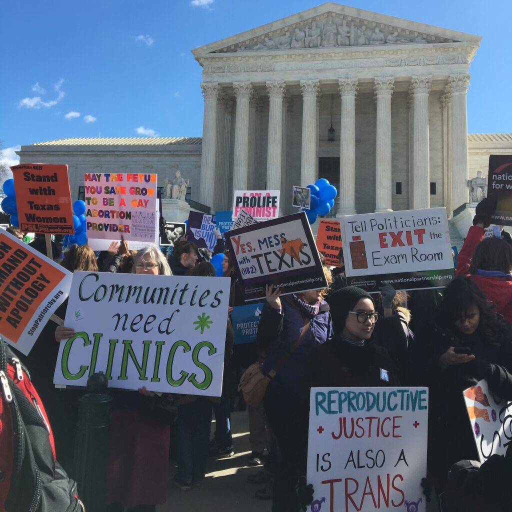 image of #stopthesham rally in front of the US Supreme Court, blue skies and lots of pro-choice signs
